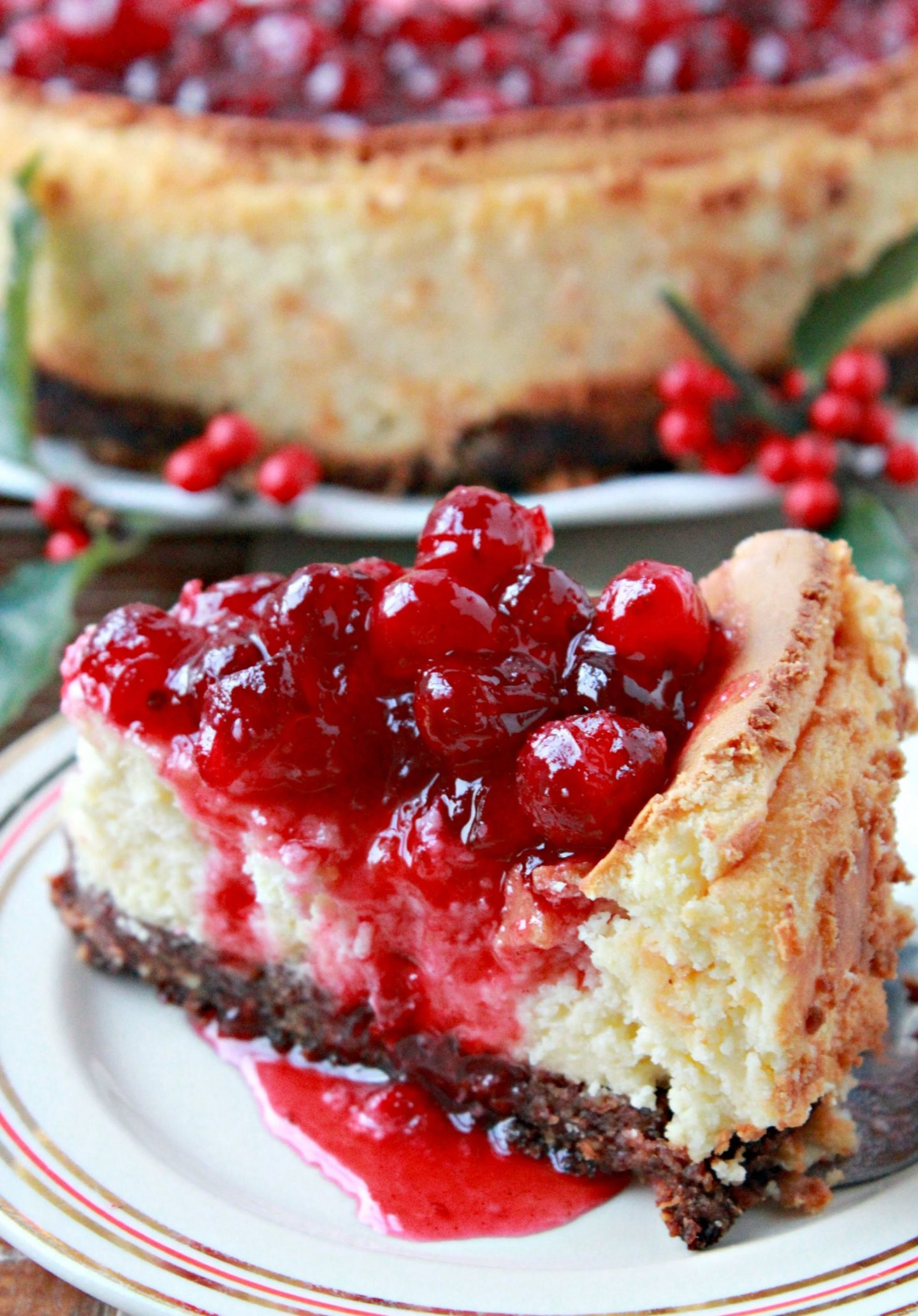 A deliciously creamy holiday cheesecake topped with a luscious sweet-tangy and perfectly spiced cranberry sauce. It is completely gluten-free so it's perfect for those on a wheat-free diet!