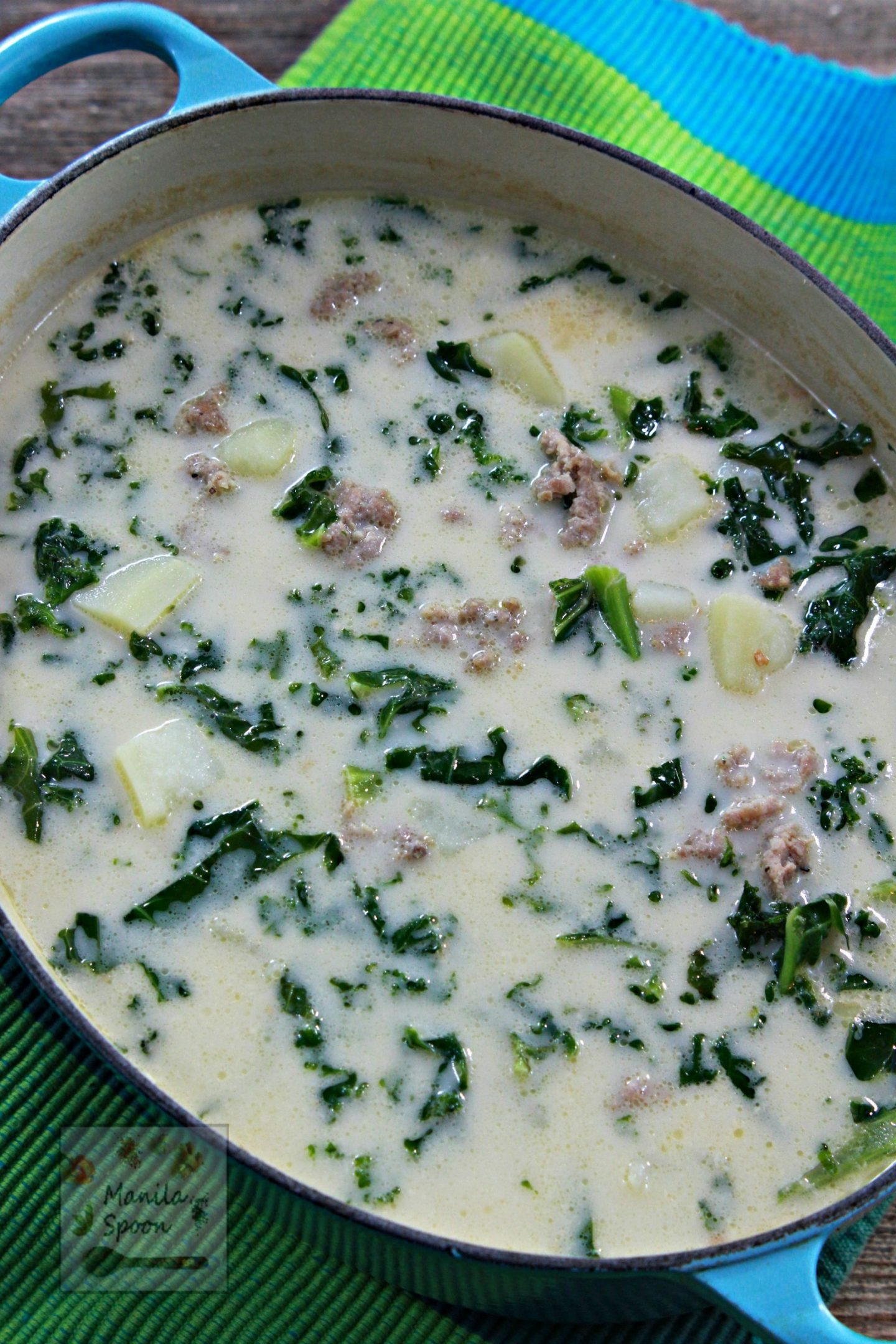 The perfect antidote for fall and winter chilly nights, a hot bowl of tasty and hearty Tuscan Sausage Potato Soup. Creamy and perfectly seasoned,  it's true comfort food in a bowl!