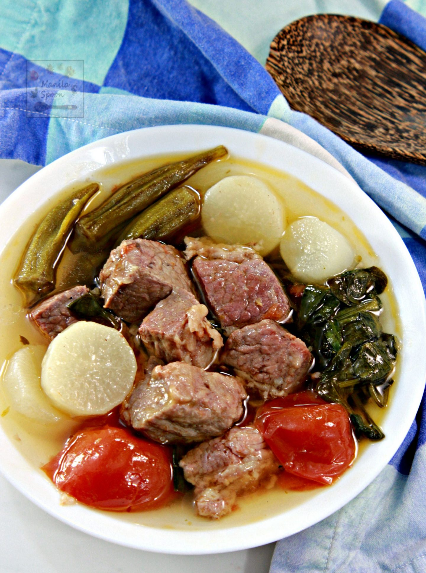 Use the slow cooker to make this Filipino favorite soup - Sinigang na Corned Beef (Corned Beef in Sour Soup). The meat comes out so tender and tasty with that unmistakable tangy and zesty flavor! Serve with rice!